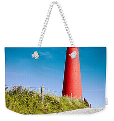 Red Lighthouse And Deep Blue Sky. Weekender Tote Bag