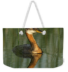 Weekender Tote Bag featuring the photograph Red-necked Grebe by James Peterson