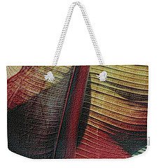 Weekender Tote Bag featuring the photograph Red Palm by Nadalyn Larsen