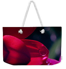 Weekender Tote Bag featuring the photograph Red Petal by Mark Greenberg
