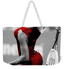Weekender Tote Bag featuring the photograph Red Cat Suit by Brian Reaves