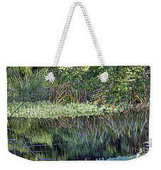 Weekender Tote Bag featuring the photograph Reed Reflections by Kate Brown