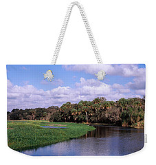 Reflection Of Clouds In A River, Myakka Weekender Tote Bag by Panoramic Images