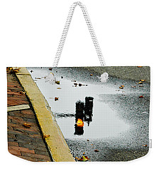 Reflection Of Traffic Light In Street Puddle Weekender Tote Bag by Gary Slawsky