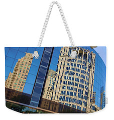 Weekender Tote Bag featuring the photograph Reflections In The Rolex Bldg. by Robert ONeil