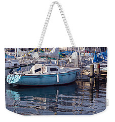 Weekender Tote Bag featuring the photograph Reflections by Muhie Kanawati