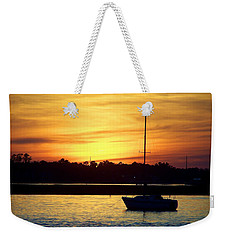 Weekender Tote Bag featuring the photograph Resting In A Mango Sunset by Sandi OReilly