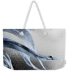 Resting On A Feather Weekender Tote Bag by Bob Orsillo