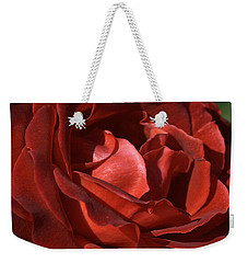 Weekender Tote Bag featuring the photograph Rich Is Rose by Joy Watson