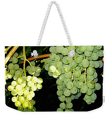 Weekender Tote Bag featuring the photograph Ripe On The Vine by Will Borden