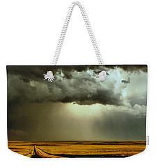 Weekender Tote Bag featuring the photograph Road Into The Storm by Steven Reed