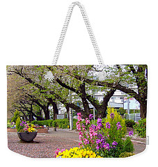 Weekender Tote Bag featuring the photograph Road Of Flowers by Andrea Anderegg