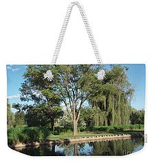 Weekender Tote Bag featuring the photograph Rose Garden  by Jeannie Rhode
