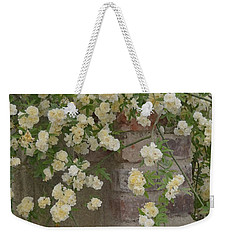 Weekender Tote Bag featuring the photograph Rose Sprawling On Stone by Tom Wurl