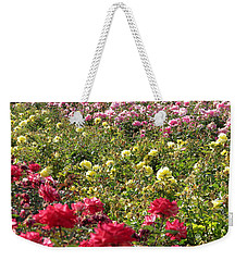 Weekender Tote Bag featuring the photograph Roses Roses Roses by Laurel Powell