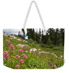 Weekender Tote Bag featuring the photograph Rosy Paintbrush And Trees by Cascade Colors