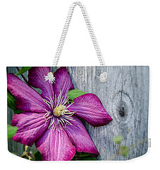 Weekender Tote Bag featuring the photograph Rustic Clematis by Susan  McMenamin