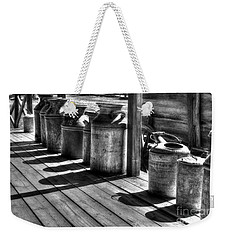 Weekender Tote Bag featuring the photograph Rusty Western Cans Bw by Mel Steinhauer