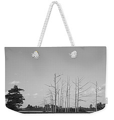 Weekender Tote Bag featuring the photograph Scenic Swamp Cypress Trees Black And White by Joseph Baril