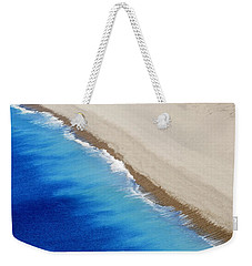 Weekender Tote Bag featuring the photograph Sea And Sand by Wendy Wilton