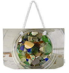 Weekender Tote Bag featuring the photograph Sea Glass In A Jar by Jean Goodwin Brooks