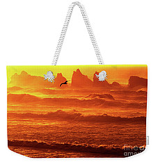 Weekender Tote Bag featuring the photograph Seagull Soaring Over The Surf At Sunset Oregon Coast by Dave Welling