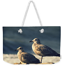 Weekender Tote Bag featuring the photograph Seagulls On A Beach by Yulia Kazansky