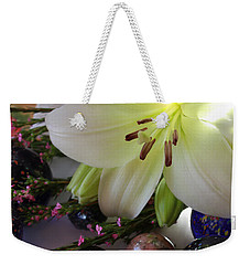 Weekender Tote Bag featuring the photograph Send The Light Lily With Marbles by Bonnie Willis