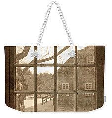 Weekender Tote Bag featuring the photograph Sepia Colonial Scene Through Antique Window by Brooke T Ryan