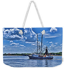 Weekender Tote Bag featuring the photograph Shrimp Boat Heading To Sea by Ludwig Keck