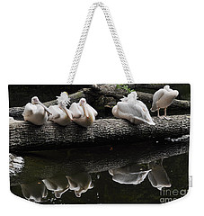 Weekender Tote Bag featuring the photograph Siesta by Simona Ghidini