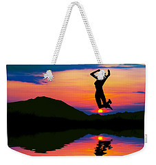 Silhouette Of Happy Woman Jumping At Sunset Weekender Tote Bag