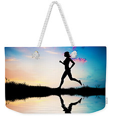 Silhouette Of Woman Running At Sunset Weekender Tote Bag