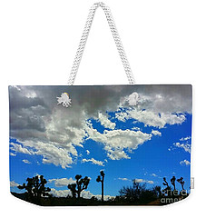Weekender Tote Bag featuring the photograph Silhouettes  by Angela J Wright
