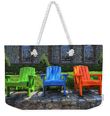 Weekender Tote Bag featuring the photograph Sit Back by Paul Wear