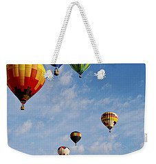 Weekender Tote Bag featuring the photograph Skyward Bound by Gina Savage