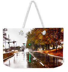 Weekender Tote Bag featuring the photograph Slick Streets Rainy View by Lesa Fine
