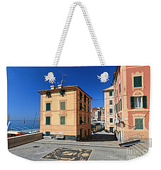 Weekender Tote Bag featuring the photograph small square in Sori by Antonio Scarpi