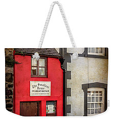 Weekender Tote Bag featuring the photograph Smallest House by Adrian Evans