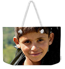 Weekender Tote Bag featuring the photograph Smiling Boy In The Swat Valley - Pakistan by Imran Ahmed