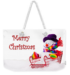 Weekender Tote Bag featuring the photograph Snowman Riding In A Red Sleigh - Christmas  by Vizual Studio