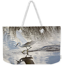 Weekender Tote Bag featuring the photograph Snowy Egret Gliding Across The Water by John M Bailey