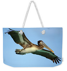 Weekender Tote Bag featuring the photograph Soaring Pelican by Suzanne Stout
