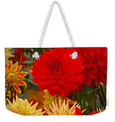 Weekender Tote Bag featuring the photograph Sockeye And Upmost Dahlias by Jordan Blackstone