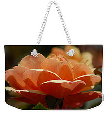 Weekender Tote Bag featuring the photograph Soft Orange Flower by Matt Harang
