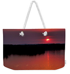 Solar Eclipse Sunset Weekender Tote Bag by Jason Politte