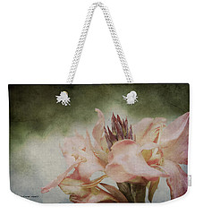 Weekender Tote Bag featuring the photograph Somebody's Beauty by Jessica Manelis