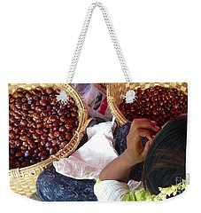Weekender Tote Bag featuring the photograph Sorting Water Chestnuts Zay Cho Street Market 29th Street Mandalay Burma by Ralph A  Ledergerber-Photography