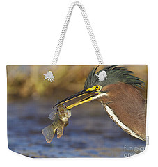 Weekender Tote Bag featuring the photograph Speared by Bryan Keil