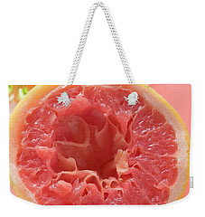 Squeezed Pink Grapefruit In Front Of Citrus Squeezer Weekender Tote Bag